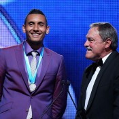 Nick Kyrgios (L) and John Newcombe on stage for the presentation of the 2014 Newcombe Medal; Getty Images