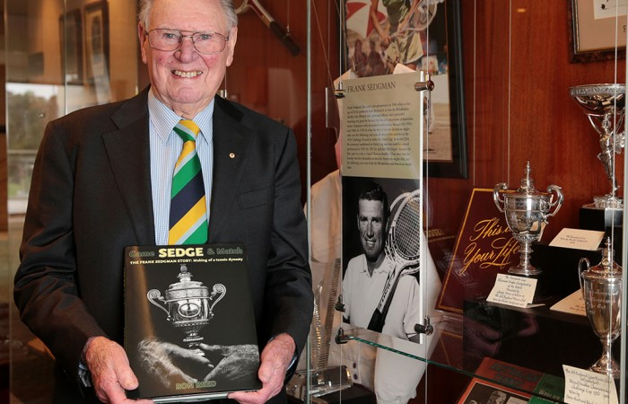 Frank Sedgman poses with his biography at Kooyong Lawn Tennis Club; Fiona Hamilton