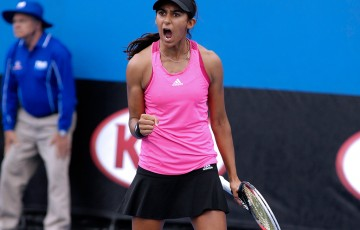 Naiktha Bains in action during the quarterfinals of the Australian Open 2015 Play-off at Melbourne Park; Mae Dumrigue