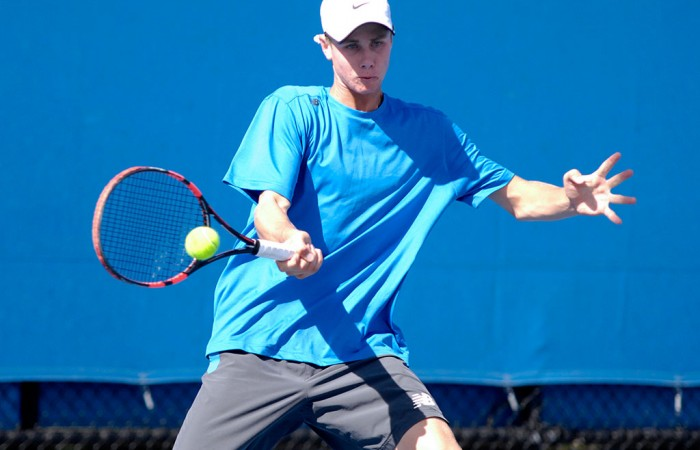 Blake Ellis competes during the first round of the boys' 16/u Australian Championships at Melbourne Park; Mae Dumrigue