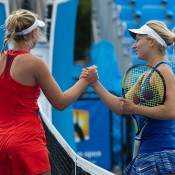 Daria Gavrilova (R) shakes hands with Abbie Myers after winning their Australian Open 2015 Play-off quarterfinal; Elizabeth Xue Bai