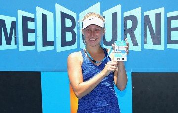 Daria Gavrilova poses with her Australian Open 2015 player accreditation following her victory in the final of the Australian Open 2015 Play-off; Getty Images