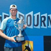 Harry Bourchier hoists the trophy after winning the  2014 18/u Australian Championships title; Elizabeth Xue Bai