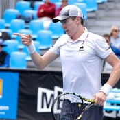 John-Patrick Smith in action in the semifinals of the Australian Open 2015 Play-off; Mae Dumrigue