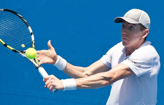 John-Patrick Smith in action during the Australian Open 2015 Play-off; Elizabeth Xue Bai