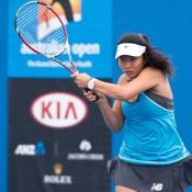 Jeanette Lin in action during her first round win at the 14/u Australian Championships at Melbourne Park; Elizabeth Xue Bai