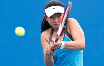 Jeanette Lin in action during the 2014 14/u Australian Championships at Melbourne Park; Elizabeth Xue Bai