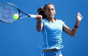 Seone Mendez in action during the Australian Open 2014 girls' singles event; Getty Images