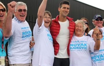 Novak Djokovic with members of the Parkes, NSW community as part of the AO Tennis Blitz in 2014; Fiona Hamilton