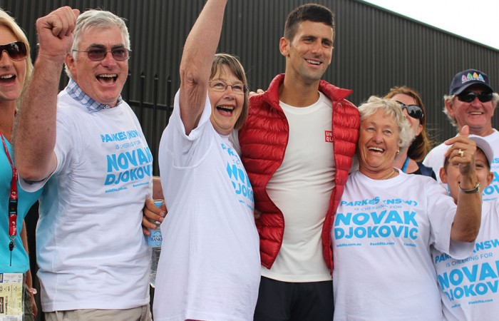 Novak Djokovic with members of the Parkes, NSW community as part of the AO Tennis Blitz in 2014; Fiona Hamilton