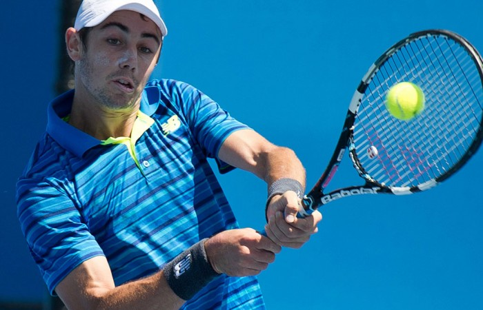 Jordan Thompson in action during his first round win at the Australian Open 2015 Play-off; Elizabeth Xue Bai