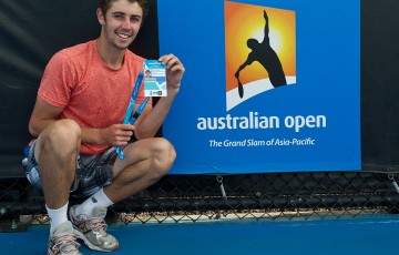 Jordan Thompson poses with his Australian Open 2015 player accreditation following victory in the final of the Australian Open 2015 Play-off; Elizabeth Xue Bai