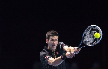 Novak Djokovic of Serbia in action during his round robin singles match against Tomas Berdych of Czech Republic on day five of the Barclays ATP World Tour Finals at O2 Arena on November 14, 2014 in London, England.  (Photo by Justin Setterfield/Getty Images)