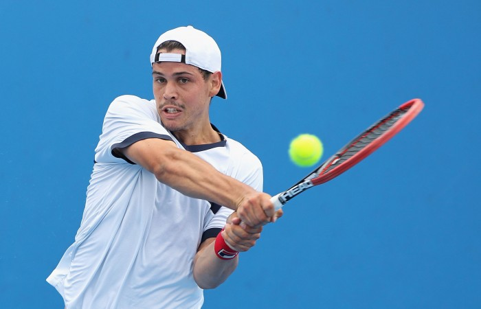 Alex Bolt of Australia plays a backhand in his first round match against Marc Polmans of Australia during the 2015 Australian Open play off at Melbourne Park on December 15, 2014 in Melbourne, Australia.  (Photo by Robert Prezioso/Getty Images)