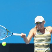 Anastasia Rodionova of Australia plays a forehand in her first round match against Naiktha Bains of Australia during the 2015 Australian Open play off at Melbourne Park on December 16, 2014 in Melbourne, Australia.  (Photo by Robert Prezioso/Getty Images)