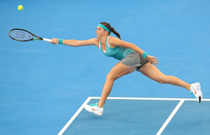 BRISBANE, AUSTRALIA - JANUARY 04:  Ajla Tomljanovic of Croatia stretches for a forehand in her match against Jelena Jankovic of Serbia during day one of the 2015 Brisbane International at Pat Rafter Arena on January 4, 2015 in Brisbane, Australia.  (Photo by Chris Hyde/Getty Images)