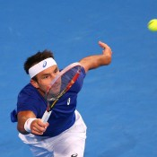 Marinko Matosevic of Australia plays a forehand in his singles match against  Andy Murray of Great Britainduring day six of the 2015 Hopman Cup at Perth Arena on January 9, 2015 in Perth, Australia.  (Photo by Paul Kane/Getty Images)