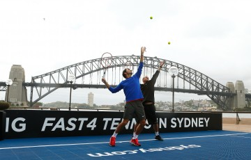 SYDNEY, AUSTRALIA - JANUARY 12:  Roger Federer of Switzerland and Lleyton Hewitt of Australia hit some balls for the cameras during the launch of Fast 4 Tennis in front of the Sydney Harbour Bridge on January 12, 2015 in Sydney, Australia.  (Photo by Daniel Munoz/Getty Images)