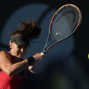 Casey Dellacqua of Australia plays a backhand in her first round match against Lauren Davis of the USA during day two of the 2015 Hobart International at Domain Tennis Centre on January 12, 2015 in Hobart, Australia.  (Photo by Mark Metcalfe/Getty Images)