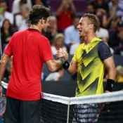 Roger Federer of Switzerland (L) shakes hands with Lleyton Hewitt of Australia (R) after their match at Qantas Credit Union Arena on January 12, 2015 in Sydney, Australia.  (Photo by Matt King/Getty Images)