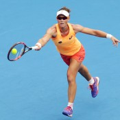 Samantha Stosur of Australia plays a forehand in her match against Barbora Zahlavova Strycova of the Czech Republic during day three of the Sydney International at Sydney Olympic Park Tennis Centre on January 13, 2015 in Sydney, Australia.  (Photo by Matt King/Getty Images)