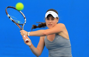 Kimberly Birrell plays a backhand.