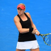Jessica Moore plays a backhand during qualifying for 2015 Australian Open at Melbourne Park on January 15, 2015 in Melbourne, Australia.