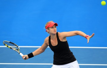 Jessica Moore plays a forehand/backhand in his/her qualifying match against Fiona Ferro during qualifying for 2015 Australian Open at Melbourne Park on January 15, 2015 in Melbourne, Australia.