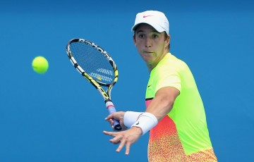 MELBOURNE, AUSTRALIA - JANUARY 16:  Andrew Harris of Australia plays a forehand in his qualifying match against Andreas Beck of Germany for 2015 Australian Open at Melbourne Park on January 16, 2015 in Melbourne, Australia.  (Photo by Robert Prezioso/Getty Images)