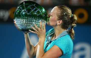 SYDNEY, AUSTRALIA - JANUARY 16:  Petra Kvitova of the Czech Republic kisses the trophy after winning the Womens Singles Final match against Karolina Pliskova of the Czech Republic during day six of the 2015 Sydney International at Sydney Olympic Park Tennis Centre on January 16, 2015 in Sydney, Australia.  (Photo by Brendon Thorne/Getty Images)