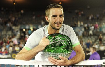 SYDNEY, AUSTRALIA - JANUARY 17:  Viktor Troicki of Serbia poses for a photo with the APIA International Trophy after victory in the Men's Singles Final match against Mikhail Kukushkin of Kazakhstan during day seven of the 2015 Sydney International at Sydney Olympic Park Tennis Centre on January 17, 2015 in Sydney, Australia.  (Photo by Brett Hemmings/Getty Images)