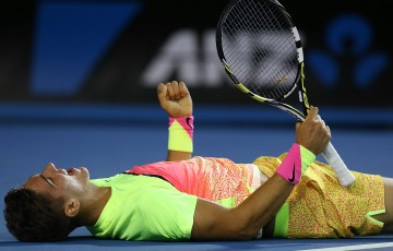 MELBOURNE, AUSTRALIA - JANUARY 19: Thanasi Kokkinakis of Australia celebrates winning in his first round match against Ernests Gulbis of Latvia during day one of the 2015 Australian Open at Melbourne Park on January 19, 2015 in Melbourne, Australia. (Photo by Michael Dodge/Getty Images)