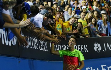 MELBOURNE, AUSTRALIA - JANUARY 19: Thanasi Kokkinakis of Australia celebrates with fans after winning in his first round match against Ernests Gulbis of Latvia during day one of the 2015 Australian Open at Melbourne Park on January 19, 2015 in Melbourne, Australia. (Photo by Michael Dodge/Getty Images)