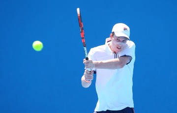 MELBOURNE, AUSTRALIA - JANUARY 24:  Jake Delaney of Australia plays a shot in his match against Johan Nikles of Switzerland during the Australian Open 2015 Junior Championships at Melbourne Park on January 24, 2015 in Melbourne, Australia.  (Photo by Patrick Scala/Getty Images)