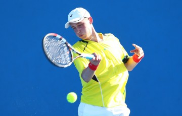 MELBOURNE, AUSTRALIA - JANUARY 24:  Marc Polmans of Australia plays a forehand in his match against Corentin Denolly of France during the Australian Open 2015 Junior Championships at Melbourne Park on January 24, 2015 in Melbourne, Australia.  (Photo by Cameron Spencer/Getty Images)