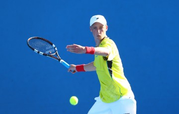 MELBOURNE, AUSTRALIA - JANUARY 24:  Marc Polmans of Australia in action in his match against Corentin Denolly of France during the Australian Open 2015 Junior Championships at Melbourne Park on January 24, 2015 in Melbourne, Australia.  (Photo by Cameron Spencer/Getty Images)