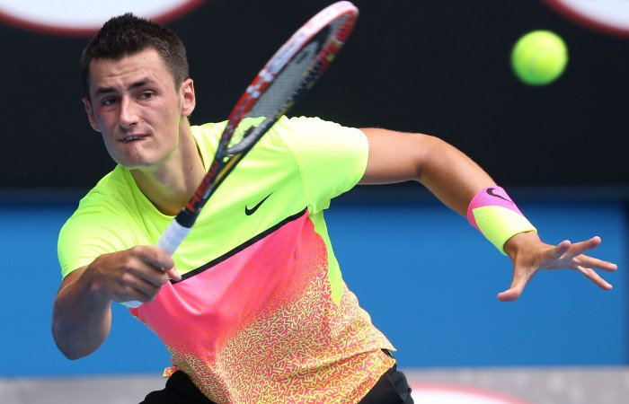 MELBOURNE, AUSTRALIA - JANUARY 25:  Bernard Tomic of Australia plays a forehand in his fourth round match against Tomas Berdych of the Czech Republic during day seven of the 2015 Australian Open at Melbourne Park on January 25, 2015 in Melbourne, Australia.  (Photo by Michael Dodge/Getty Images)