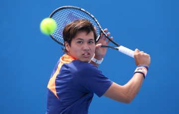 MELBOURNE, AUSTRALIA - JANUARY 25:  Akira Santillan of Australia in action in his match against Boris Pokotilov of Russia during the Australian Open 2015 Junior Championships at Melbourne Park on January 25, 2015 in Melbourne, Australia.  (Photo by Hannah Peters/Getty Images)