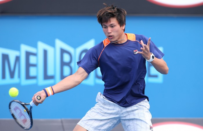 MELBOURNE, AUSTRALIA - JANUARY 29:  Akira Santillan of Australia in action in his match against Duck Hee Lee of Korea during the Australian Open 2015 Junior Championships at Melbourne Park on January 29, 2015 in Melbourne, Australia.  (Photo by Patrick Scala/Getty Images)