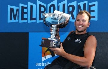 MELBOURNE, AUSTRALIA - JANUARY 31:  Dylan Alcott of Australia celebrates with the winners trophy after his final Quad Wheelchair match against David Wagner of the United States during the Australian Open 2015 Wheelchair Championships at Melbourne Park on January 31, 2015 in Melbourne, Australia.  (Photo by Robert Prezioso/Getty Images)
