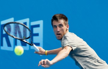 Damir Dzumhur of Bosnia and Herzegovina plays a forehand in his third round match against Tomas Berdych of the Czech Republic during day five of the 2014 Australian Open at Melbourne Park on January 17, 2014 in Melbourne, Australia.  (Photo by Scott Barbour/Getty Images)