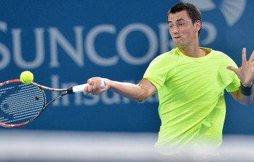 Bernard Tomic of Australia plays a forehand in his match against Sam Querrey of the USA during day two of the 2015 Brisbane International at Pat Rafter Arena on January 5, 2015 in Brisbane, Australia.  (Photo by Bradley Kanaris/Getty Images)