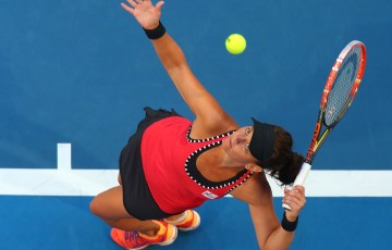 Casey Dellacqua of Australia serves in her singles match against Heather Watson of Great Britain during day six of the 2015 Hopman Cup at Perth Arena on January 9, 2015 in Perth, Australia.  (Photo by Paul Kane/Getty Images)