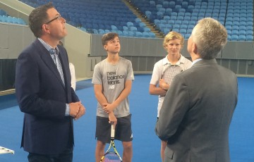 Victorian Premier Daniel Andrews (L), Australian Open tournament director Craig Tiley (R) and Australian National Acedmy athletes Lucas Vuradin and Todd Millington watch the opening of the Margaret Court Arena Roof; Tennis Australia