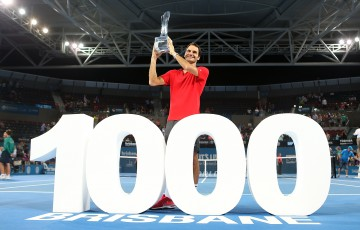Roger Federer of Switzerland holds the Roy Emerson trophy after winning his 1000 singles title after the Mens final match against Milos Raonic of Canada during day eight of the 2015 Brisbane International at Pat Rafter Arena on January 11, 2015 in Brisbane, Australia.  (Photo by Chris Hyde/Getty Images)