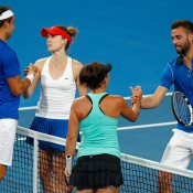 Marinko Matosevic and Casey Dellacqua of Australia congratulate Alize Cornet and Benoit Paire of France after France won the mixed doubles match during day four of the 2015 Hopman Cup at Perth Arena on January 7, 2015 in Perth, Australia.  (Photo by Will Russell/Getty Images)