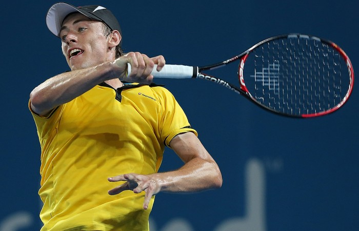 John Millman of Australia plays a forehand during his match against Andy Murray of Great Britain on day five of the Brisbane International at Pat Rafter Arena on January 3, 2013 in Brisbane, Australia.  (Photo by Chris Hyde/Getty Images)