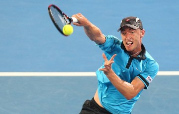 John Millman of Australia plays a forehand in his match against Roger Federer of Switzerland during day five of the 2015 Brisbane International at Pat Rafter Arena on January 8, 2015 in Brisbane, Australia.  (Photo by Chris Hyde/Getty Images)