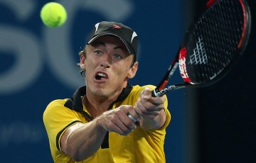 John Millman of Australia plays a backhand during his match against Andy Murray of Great Britain on during day five of the Brisbane International at Pat Rafter Arena on January 3, 2013 in Brisbane, Australia.  (Photo by Chris Hyde/Getty Images)