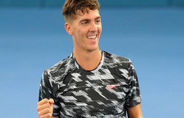 Thanasi Kokkinakis celebrates his first round victory at Brisbane International 2015 over Julien Benneteau; Getty Images